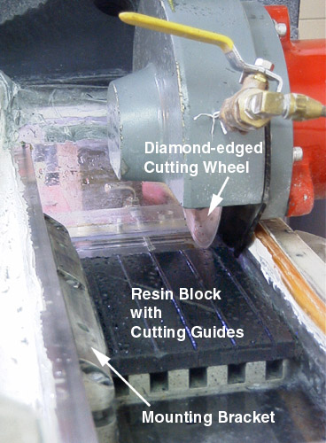High-speed cutting saw for mass-embedded otoliths in resin